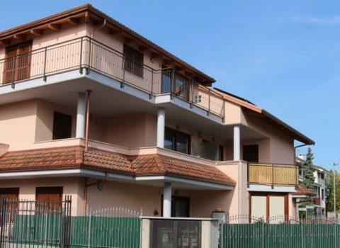 Vebo2 palazzina residenziale color rosa salmone Alpignano (To)